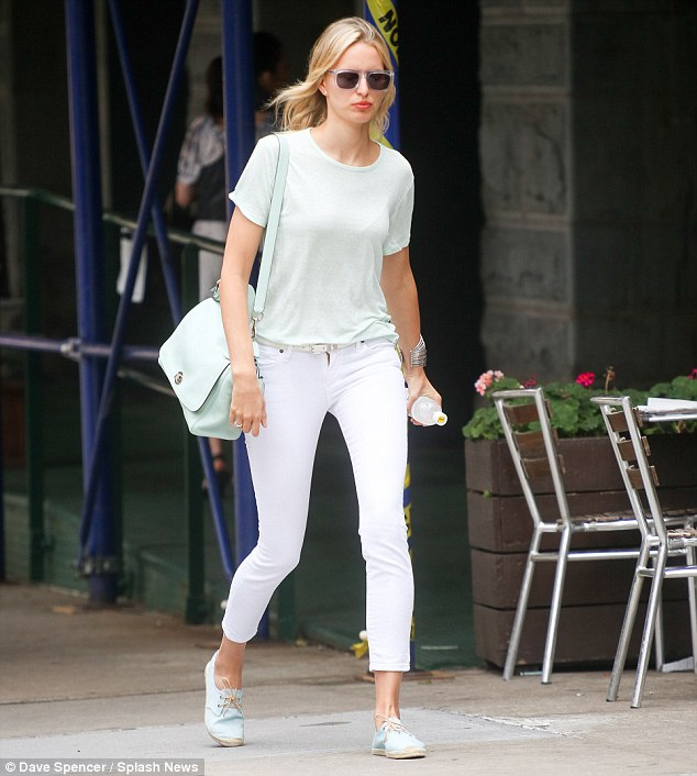 Fashion conscious: Even during a casual errand run, Karolina managed to look chic as she paired her jeans with comfy T-shirt and designer handbag