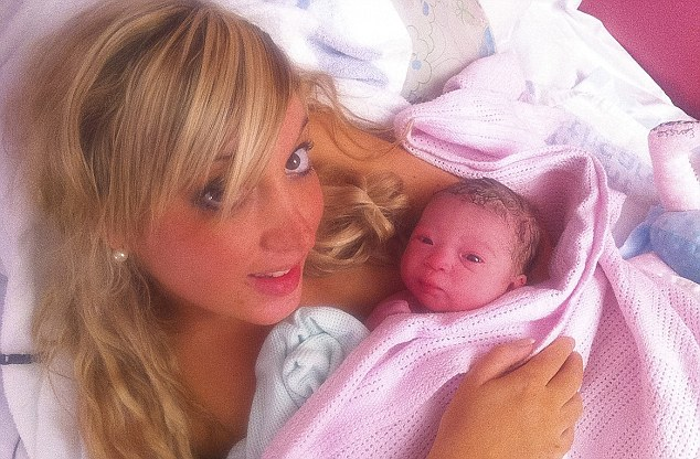 Committed: Heather Greig, 29, with Elvissa. Heather put on a layer of tan while in labour and wore high heels to the hospital