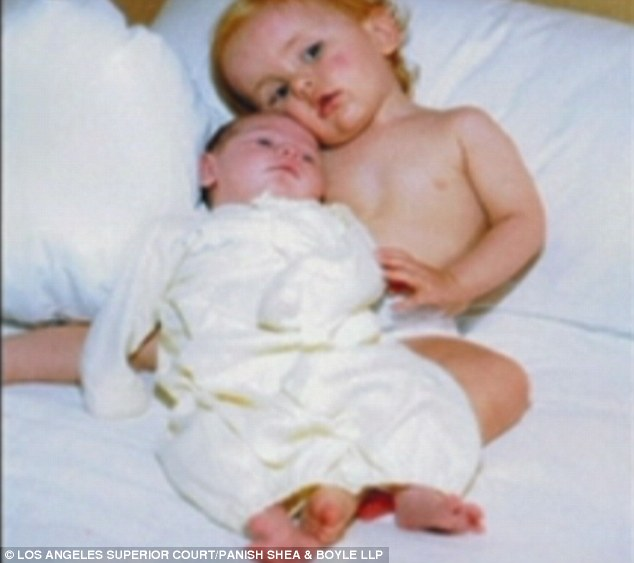 Cuddling up: One of the images shown was this cute shot of Prince with Paris as a baby