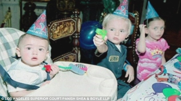 Birthday time: Prince, Paris and Blanket are seen sporting birthday hats as they enjoy a party