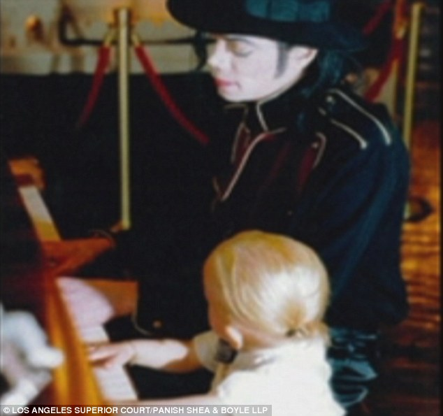 Passing on the musical talents: Michael was seen teaching Prince the piano in one of the touching shots