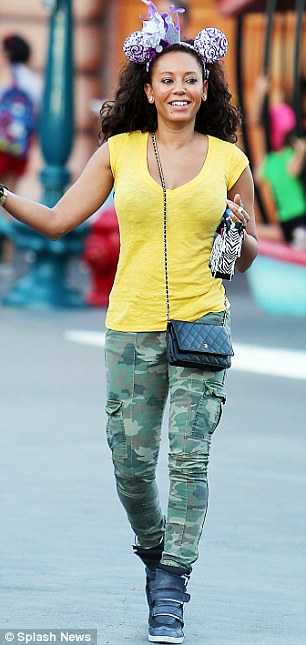 Casual style: Mel looked as chic as ever in her camouflage trousers, platform trainers and a yellow T-shirt