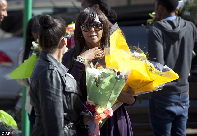 Family: The leader's granddaughter Ndileka arrived clutching a large bouquet of flowers