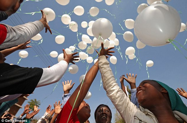 Peaceful: 95 children released balloons outside the hospital in honour of Mr Mandela, whose 95th birthday falls next month