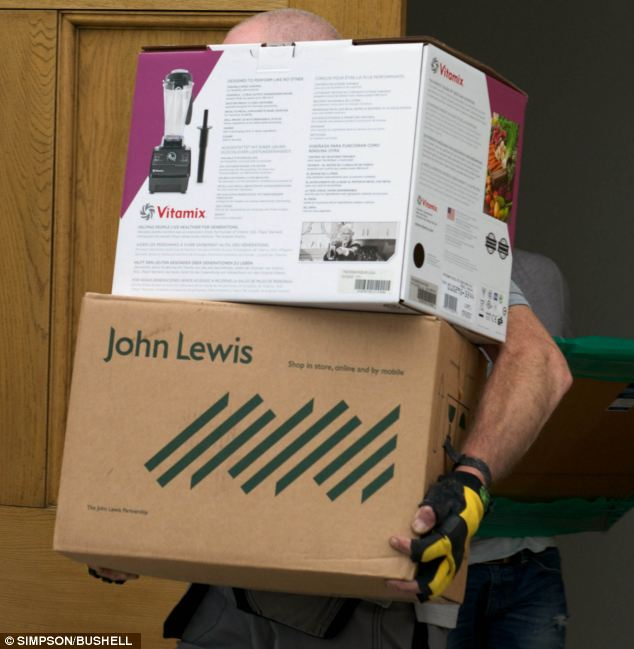 A worker removes a box which appears to contain the TV chef's blender