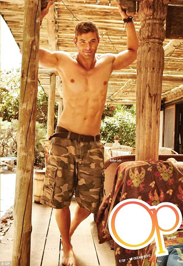 He's a beach boy, alright: Kellan Lutz stripped down to just a pair of camouflage shorts for the new OP clothing campaign, also starring Katrina Bowden