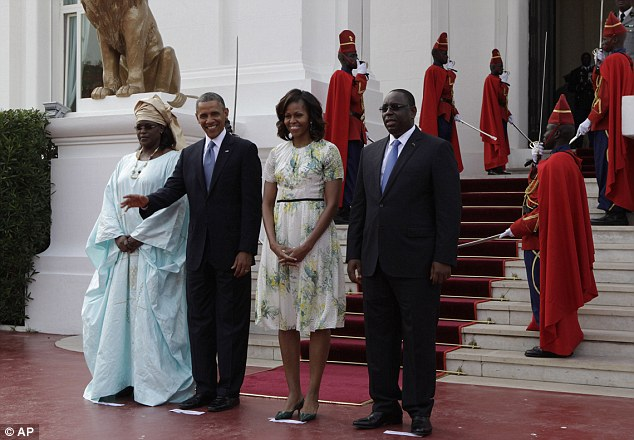 President Barack Obama waves as he poses for a picture alongside U.S. First Lady Michelle Obama, second right, Senegalese President Macky Sall, right, and Senegalese First Lady Mariame Faye Sall, at the presidential palace in Dakar, Senegal