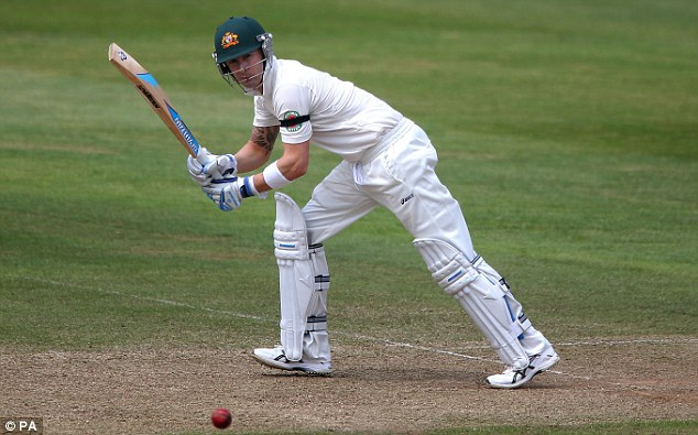 Back in action: Michael Clarke guides the ball through the leg side as he bats for the first time since March