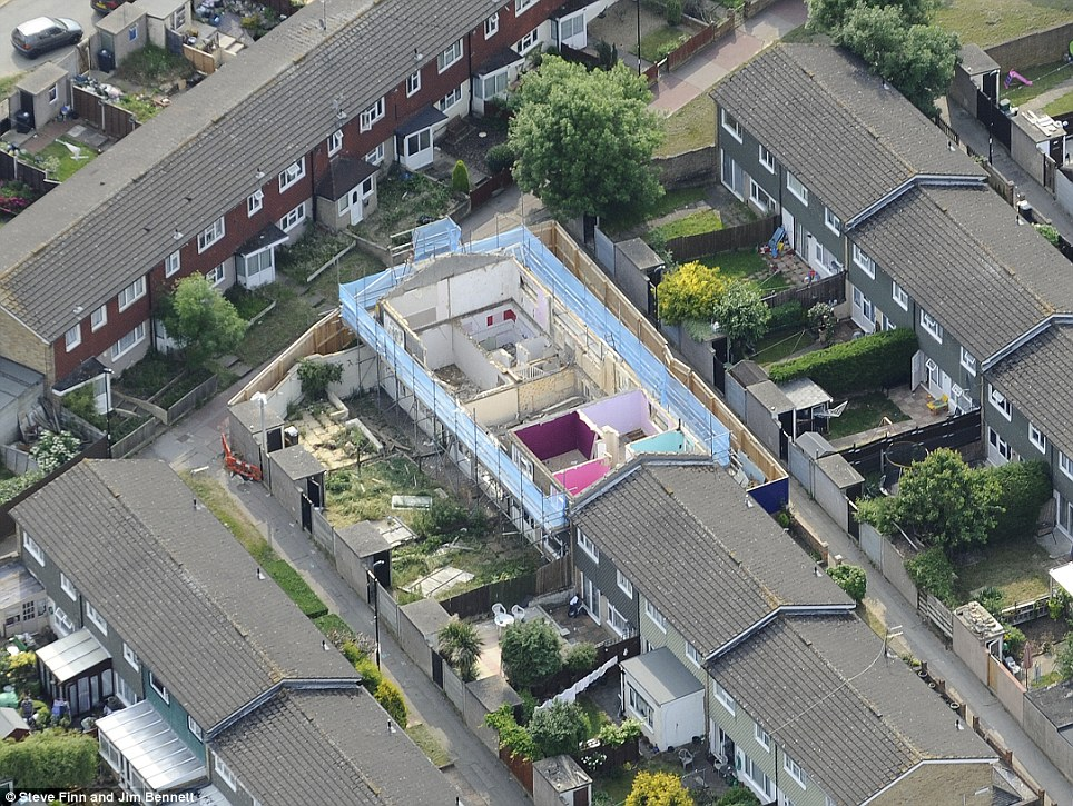 From the sky: The terrace property has been razed to the ground along with the neighbouring houses as the scene of Tia's murder is destroyed