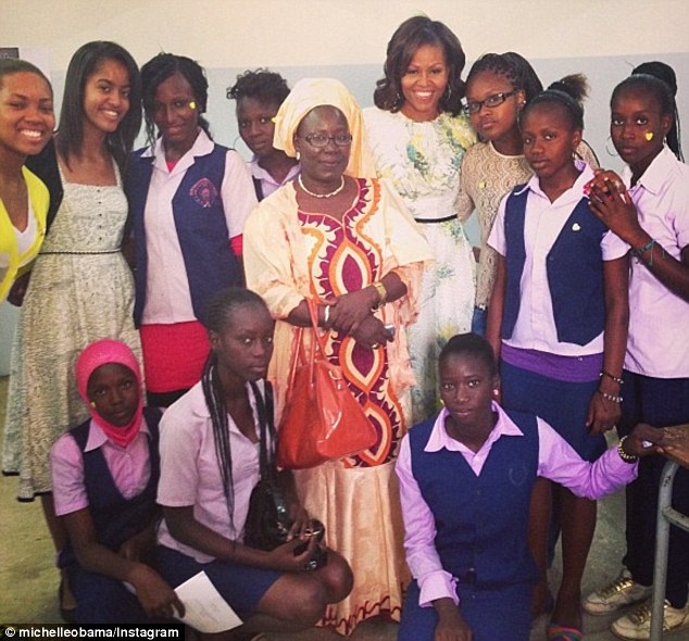 Social  butterfly: Michelle Obama has joined Instagram - she uploaded her first image this morning showing her with a group of young women from the Martin Luther King middle school in Senegal