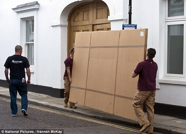 On the move: Charles Saatchi has boxes and furniture delivered to his home in Chelsea, south-west London