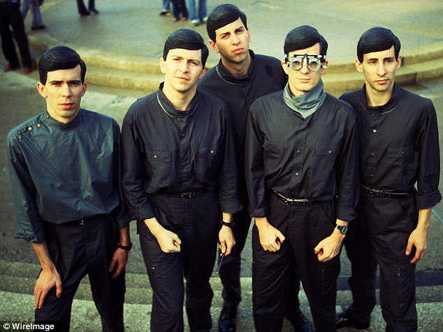 New Wave: Myers (far right) joined Devo's Bob Mothersbaugh, Mark Mothersbaugh, Gerald Casale and Bob Casale to become the sound of a generation in the 70s and 80s