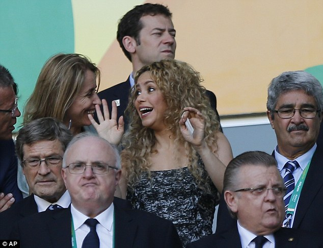 Infectious: Shakira shares her joy with the people sat around her