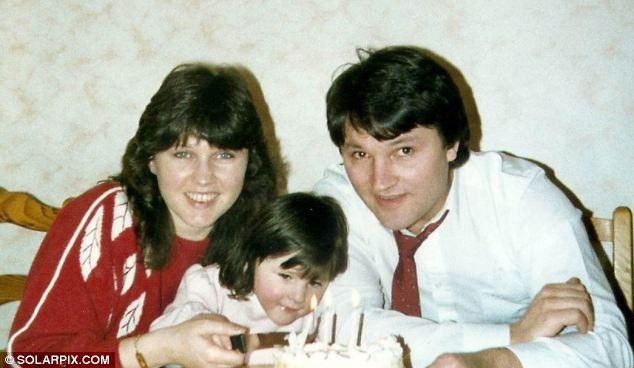 Happier times: Sheila and Philip Wood and their daughter Sophie on her third birthday