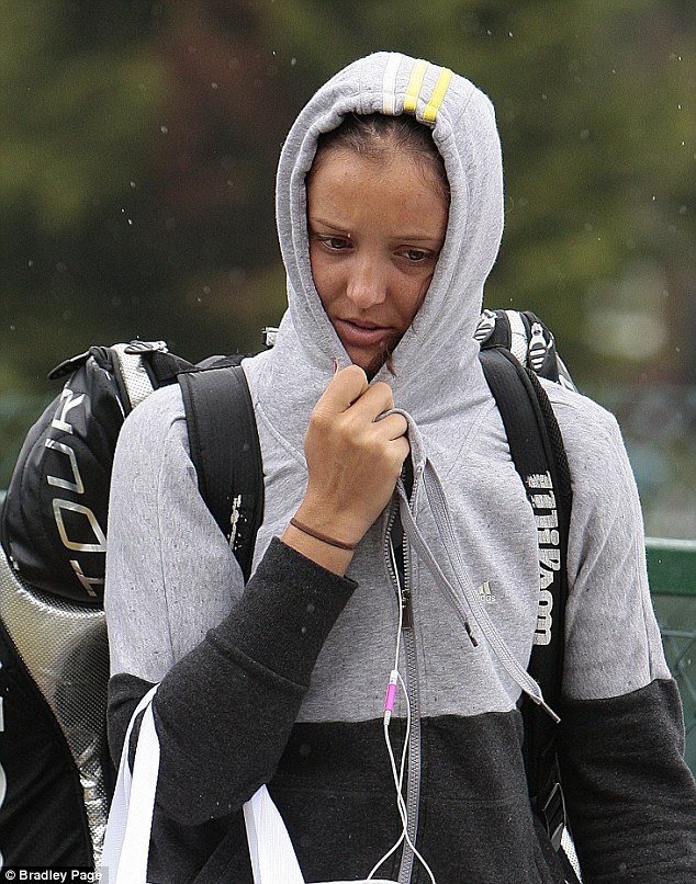 British hope: Laura Robson arrives at Wimbledon in the rain this morning