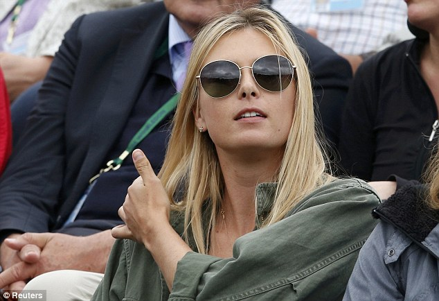 Interested spectator: Maria Sharapova takes her place to watch boyfriend Grigor Dimitrov