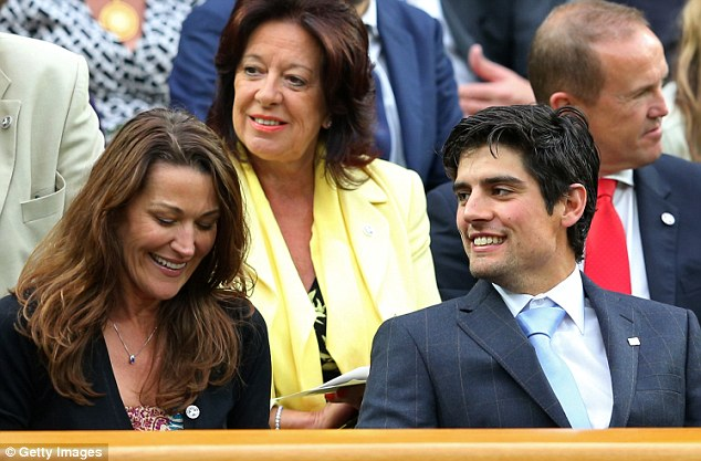Just not cricket: England captain Alistair Cook in the Royal Box alongside Ruth McDonald, the wife of former skipper Andrew Strauss