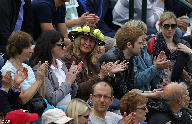 Hats off to you: A fan watches courtside for Jurgen Melzer's match against Sergiy Stakhovsky