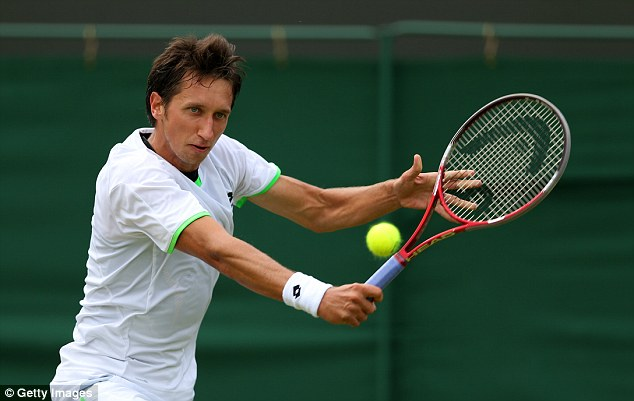 Over and out: Sergiy Stakhovsky lost in four sets to Jurgen Melzer