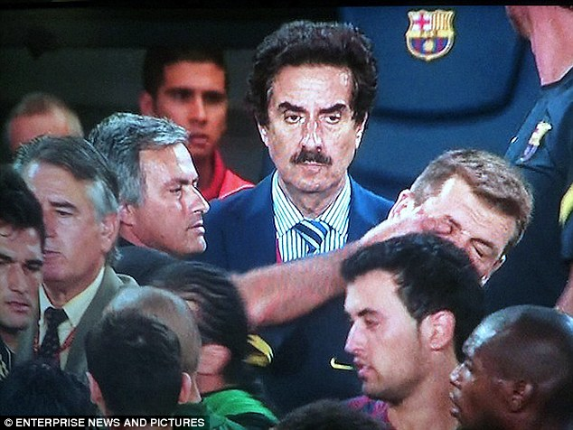 Ouch: Mourinho poked Tito Vilanova (right) in the eye during a Clasico game in 2011