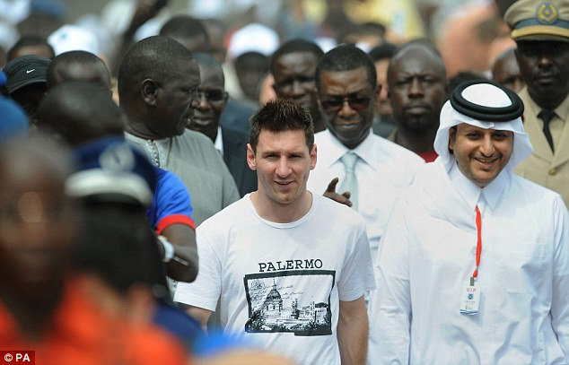 Man in the middle: Lionel Messi was in Senegal visiting the Aspire Academy