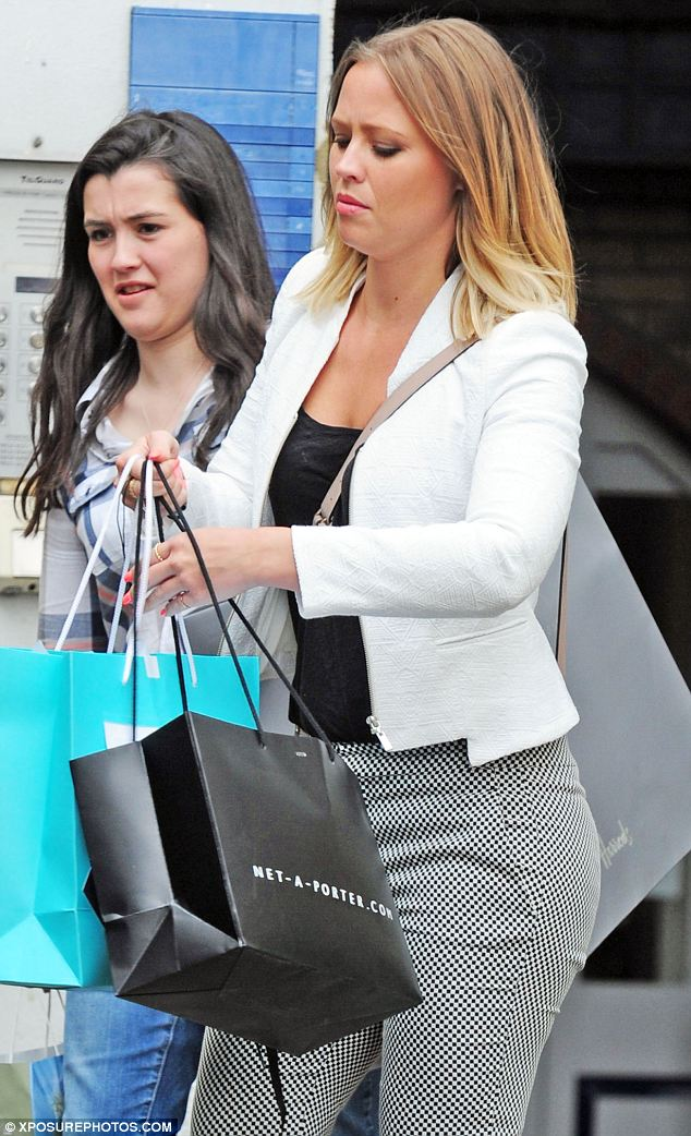Spree: Kimberley looked a little overburdened with shopping bags