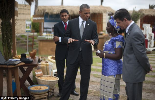Obama met the head of the Senegalese Federation of Corn Producers, Nimna Diayte, second right, during a food security event today before setting off for South Africa