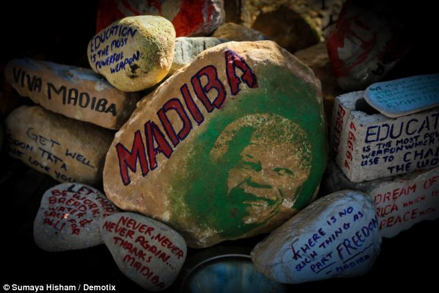 In Cape Town tributes to the ailing former president were painted on stones