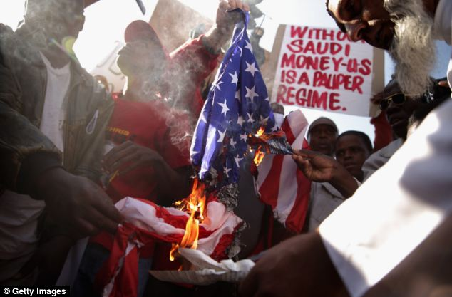 Demonstrators burned an American flag while protesting against the offical visit of Barack Obama in front of the U.S. Embassy in Pretoria