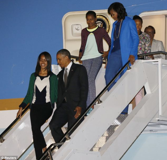 U.S. President Barack Obama, first lady Michelle Obama and their daughters Sasha and Malia arrive at Waterkloof Air Base in South Africa on Friday evening