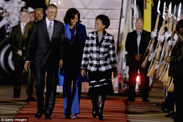 U.S. President Barack Obama and first lady Michelle Obama are greeted by Minister of International Relations and Cooperation Maite Mkoana-Mashabne after arriving in Pretoria, South Africa