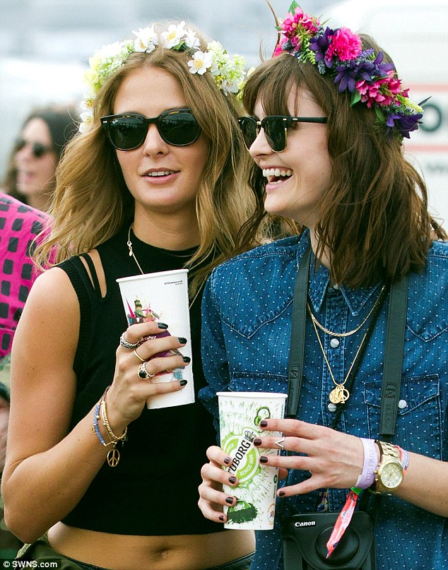 Fitting in: The girls wore floral headbands to fit in with then festival style at the music extravaganza