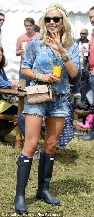 Festival style: Katherine Jenkins got into the spirit of things, as did Caroline Flack who arrived at the festival on Thursday