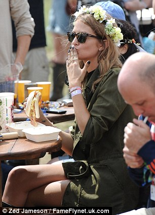 Stocking up: Millie stopped off for a bite to eat as she mingled with the other festival revellers