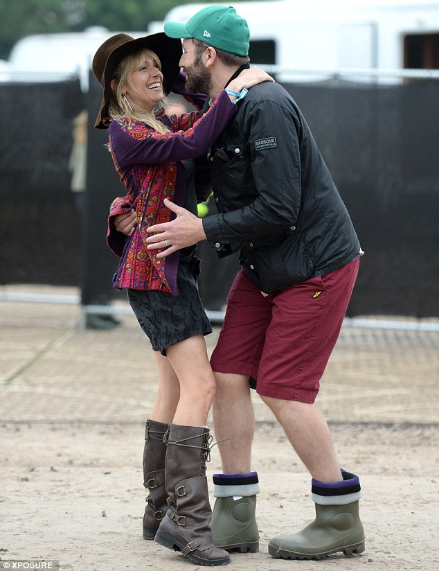 Who knew they were such good friends? Sienna Miller is ecstatic as she runs into actor Chris O'Dowd backstage on Day one of the festival