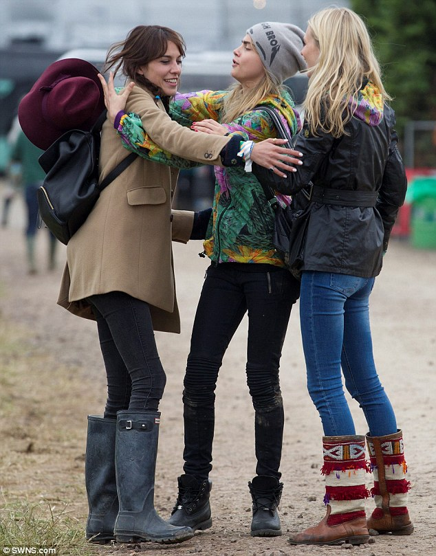 Fancy seeing you here! Cara and Poppy bump into model pal Alexa Chung as she walks through the muddy field