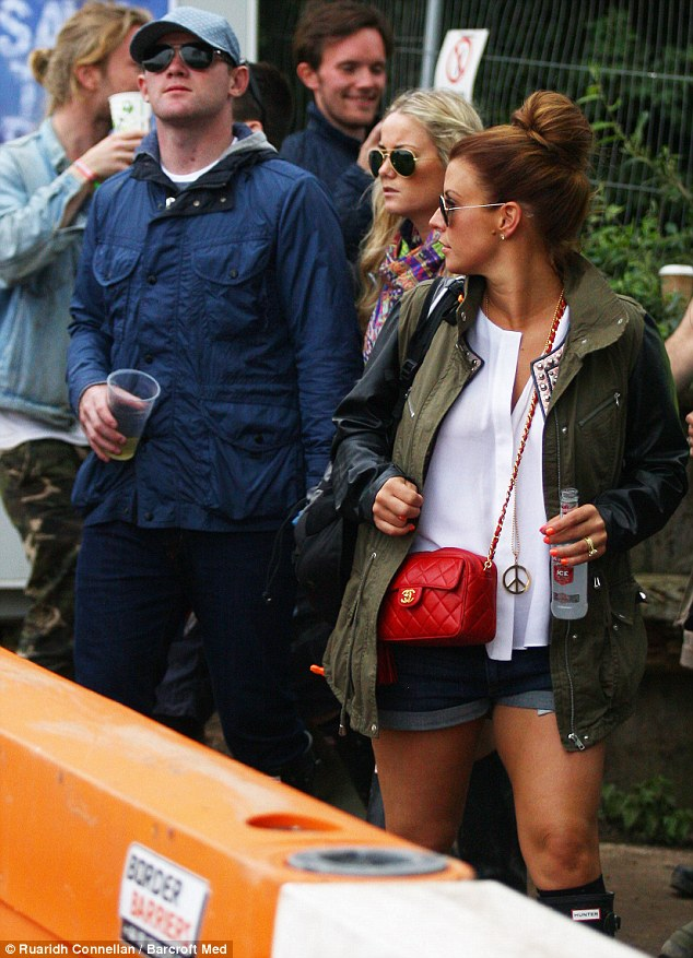 Joining in: The Rooneys also came along, with Coleen mixing a Smirnoff Ice with her Chanel bag as accessories