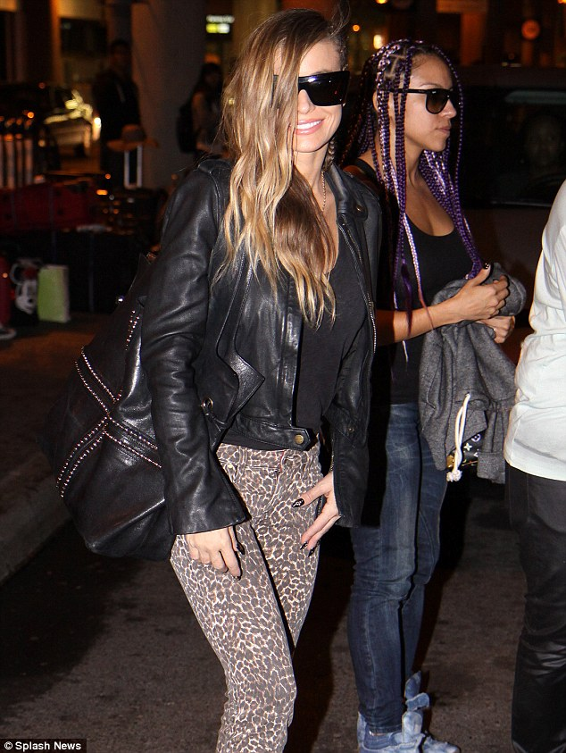 Walking on the wild side: Carmen certainly stood out with her leopard-print trousers