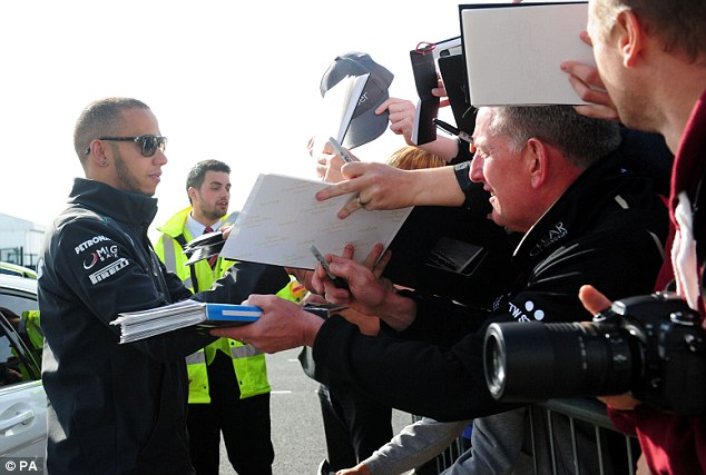 Main attraction: Lewis Hamilton signs autographs ahead of the final practice session at Silverstone