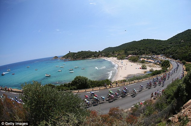 Stunning scenery: The peloton rides by the coast during stage one, a 213km road stage from Porto-Vecchio to Bastia