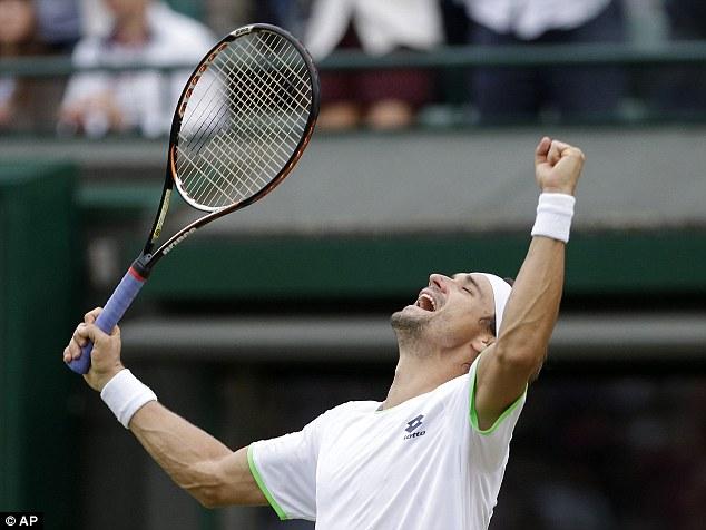 Five set thriller: David Ferrer celebrates after beating Alexandr Dolgopolov in the third round