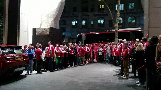 United front: Fans gather to see the Lions off from their hotel earlier today