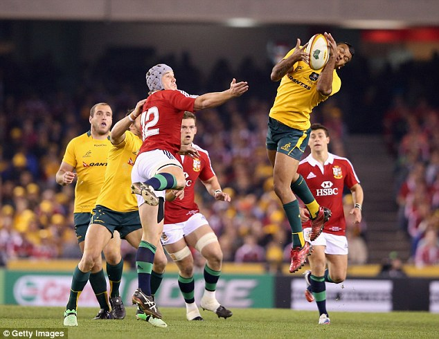 High hopes: Kurtley Beale gathers the ball under pressure as Australia look to mount an attack of their own