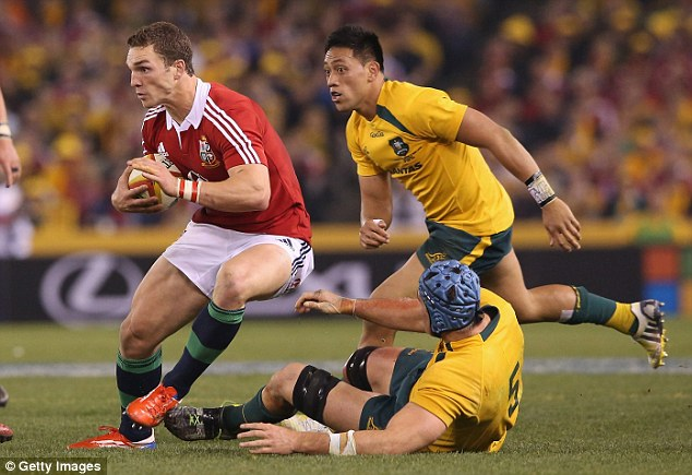 North star: Sportsmail columnist George North sidesteps an Australian tackle