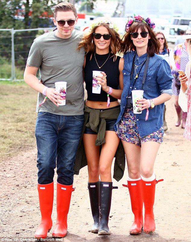 Making the most of it: Pro Green had earlier been seen enjoying the festival with girlfriend Millie Mackintosh and her model friend