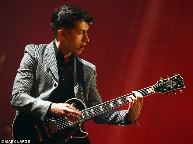 Turning heads: Alex Turner of the Arctic Monkeys played earnestly as the band's set went well into the night