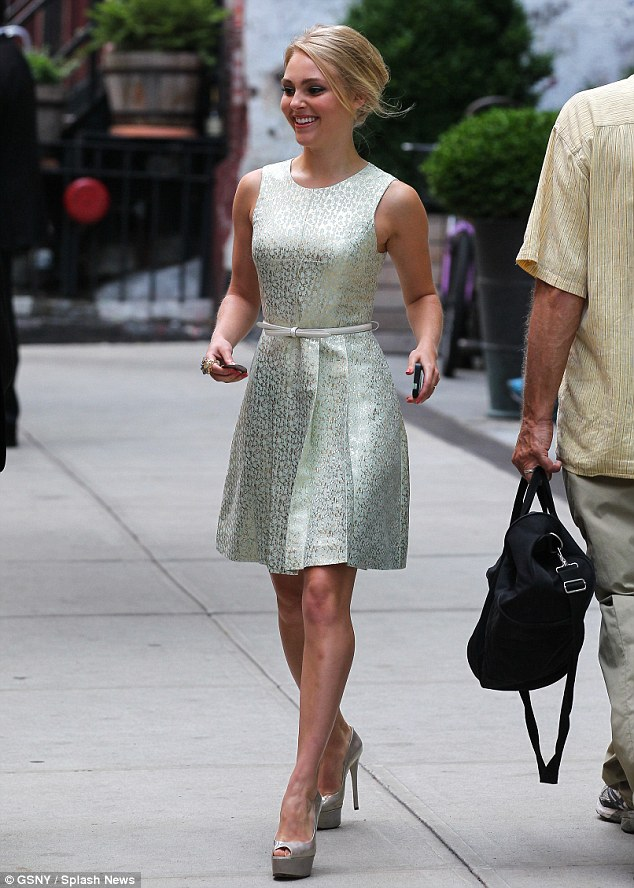 Graceful: AnnaSophia was class all the way in her shimmery A-line frock on Friday as she left a New York hotel