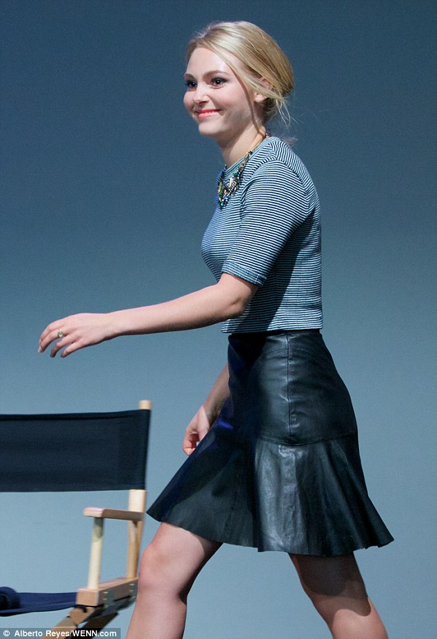 Riveting in leather: The actress donned a flaring black leather skirt and striped top for the meet and greet