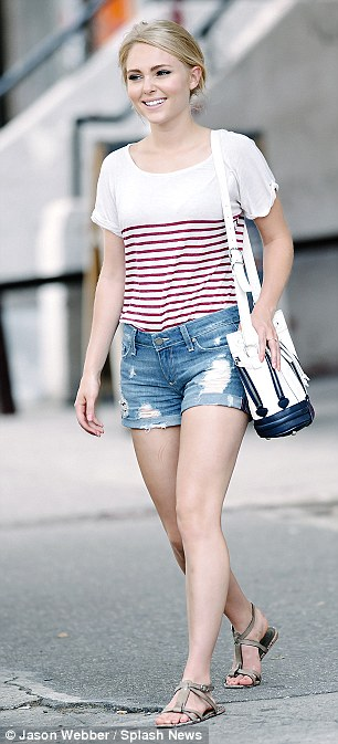 Cut offs made cute: The blonde star dressed down this time in splotchy denim shorts and a striped top