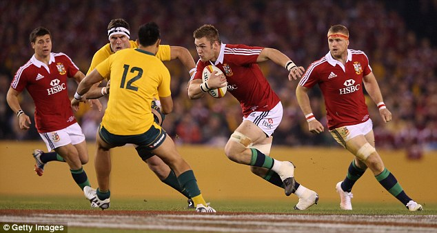 On a charge: Lydiate takes on the Wallabies defence